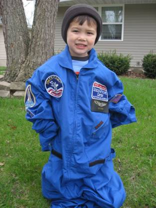 student wearing an oversized space camp uniform